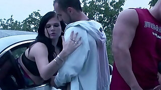 A girl is getting undressed in a car befor joining PUBLIC sex dogging orgy - Brazzers porno